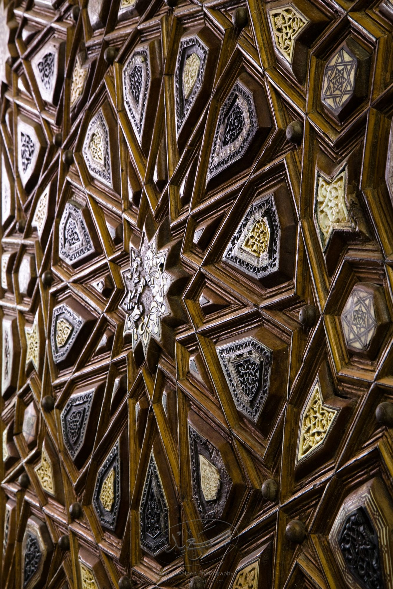 """Dodecagons. Minbar, Carved Woodwork and Inlay Detail""The late-13th / early-14th c. Mamluk minbar, or pulpit, of Sultan al-Nasir Muhammad, the ninth Mamluk Sultan from Cairo and son of Qalawun. The minbar was located in the Umayyad Mosque in Aleppo, Haleb, prior to its damage and disappearance in May 2013."