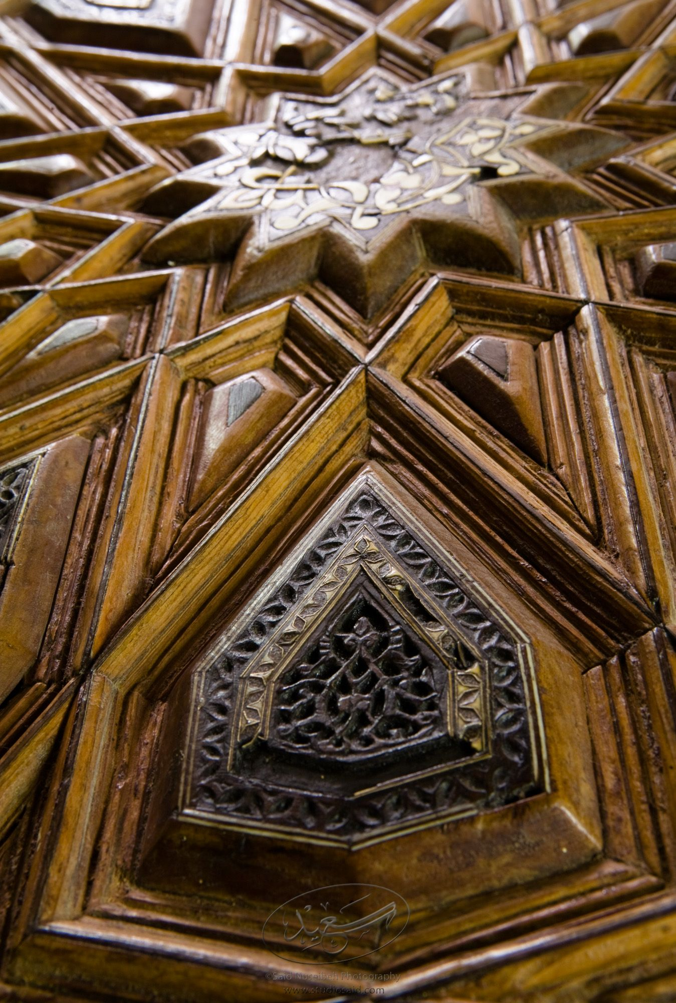 """Broken Star and Interlace Lozenge. Minbar, Carved Woodwork and Inlay Detail""The late-13th / early-14th c. Mamluk minbar, or pulpit, of Sultan al-Nasir Muhammad, the ninth Mamluk Sultan from Cairo and son of Qalawun. The minbar was located in the Umayyad Mosque in Aleppo, Haleb, prior to its damage and disappearance in May 2013."