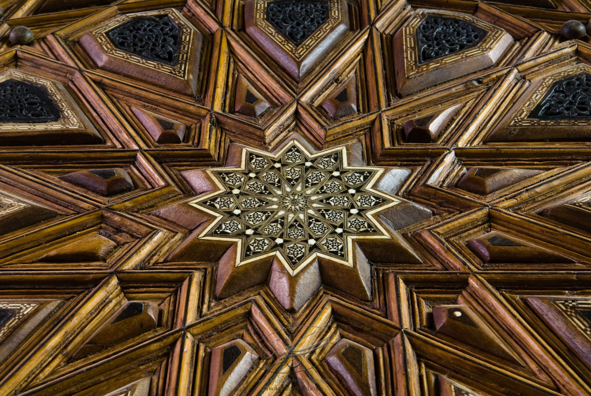 """Radiating Dodecagon. Minbar, Carved Woodwork and Inlay Detail""The late-13th / early-14th c. Mamluk minbar, or pulpit, of Sultan al-Nasir Muhammad, the ninth Mamluk Sultan from Cairo and son of Qalawun. The minbar was located in the Umayyad Mosque in Aleppo, Haleb, prior to its damage and disappearance in May 2013."