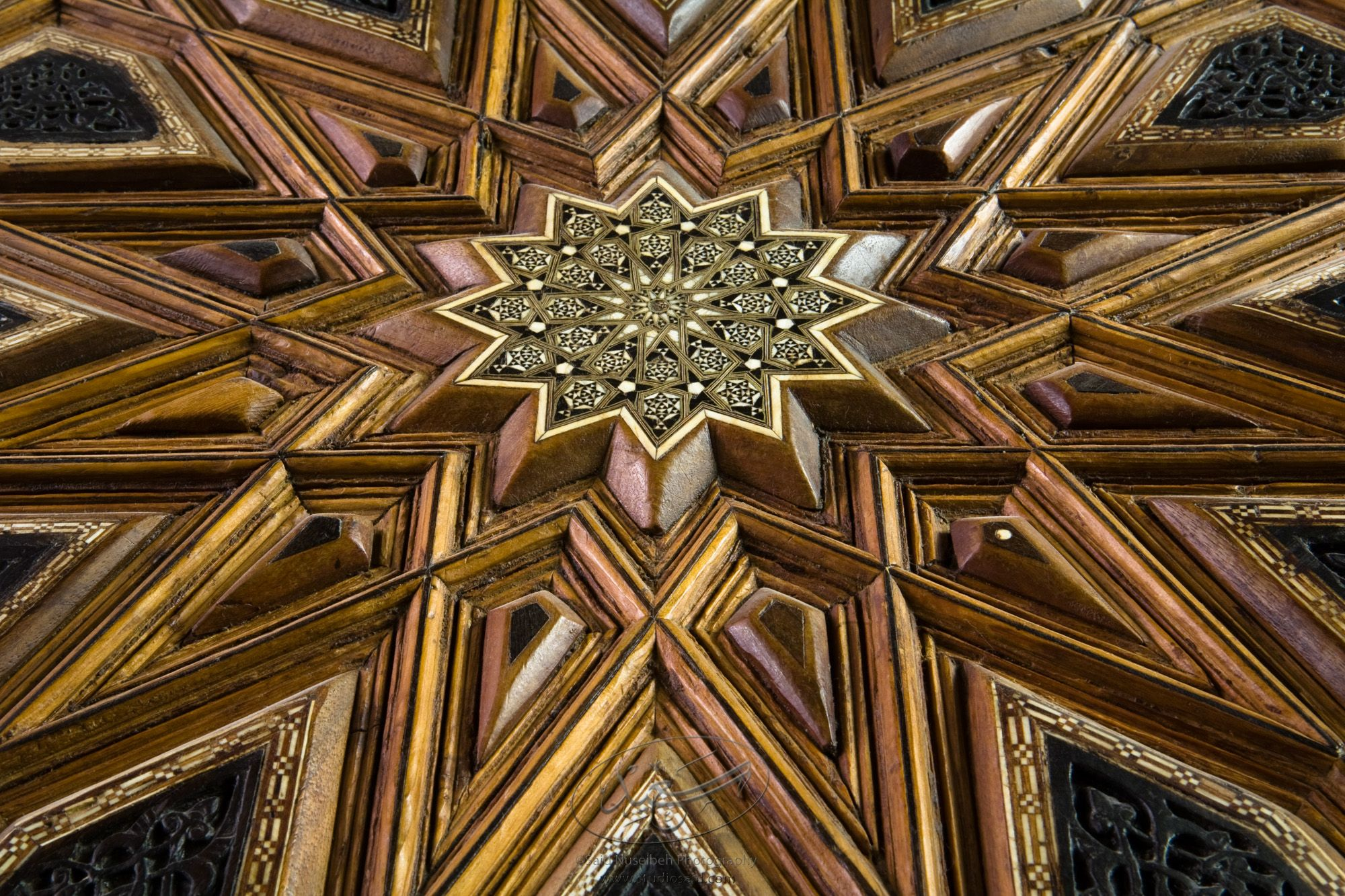 """Twelve-sided stars. Minbar, Carved Woodwork and Inlay Detail""The late-13th / early-14th c. Mamluk minbar, or pulpit, of Sultan al-Nasir Muhammad, the ninth Mamluk Sultan from Cairo and son of Qalawun. The minbar was located in the Umayyad Mosque in Aleppo, Haleb, prior to its damage and disappearance in May 2013."