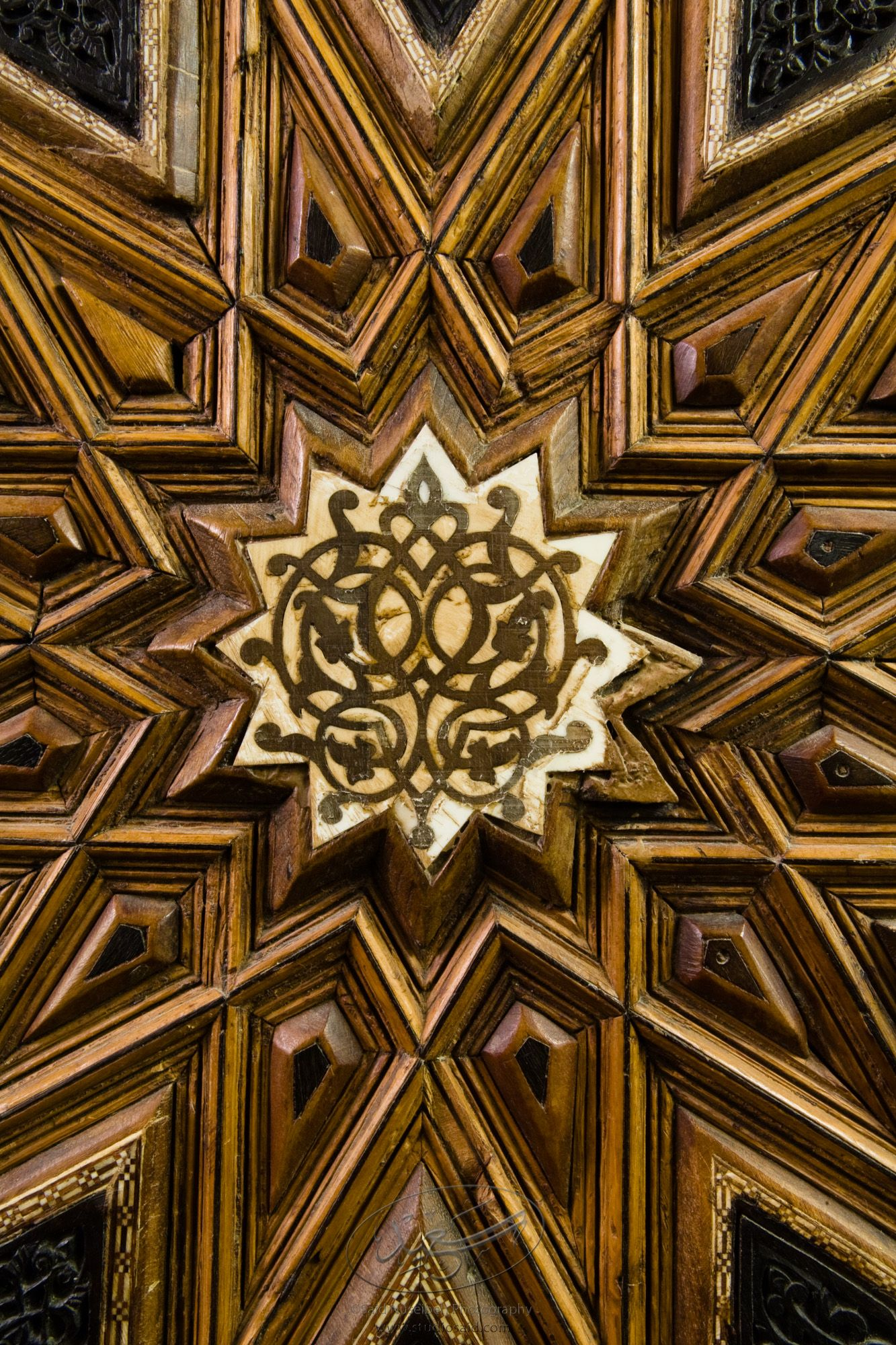 """Symmetrical Floral Interlace inside Dodecagons. Minbar, Carved Woodwork and Inlay Detail""The late-13th / early-14th c. Mamluk minbar, or pulpit, of Sultan al-Nasir Muhammad, the ninth Mamluk Sultan from Cairo and son of Qalawun. The minbar was located in the Umayyad Mosque in Aleppo, Haleb, prior to its damage and disappearance in May 2013."